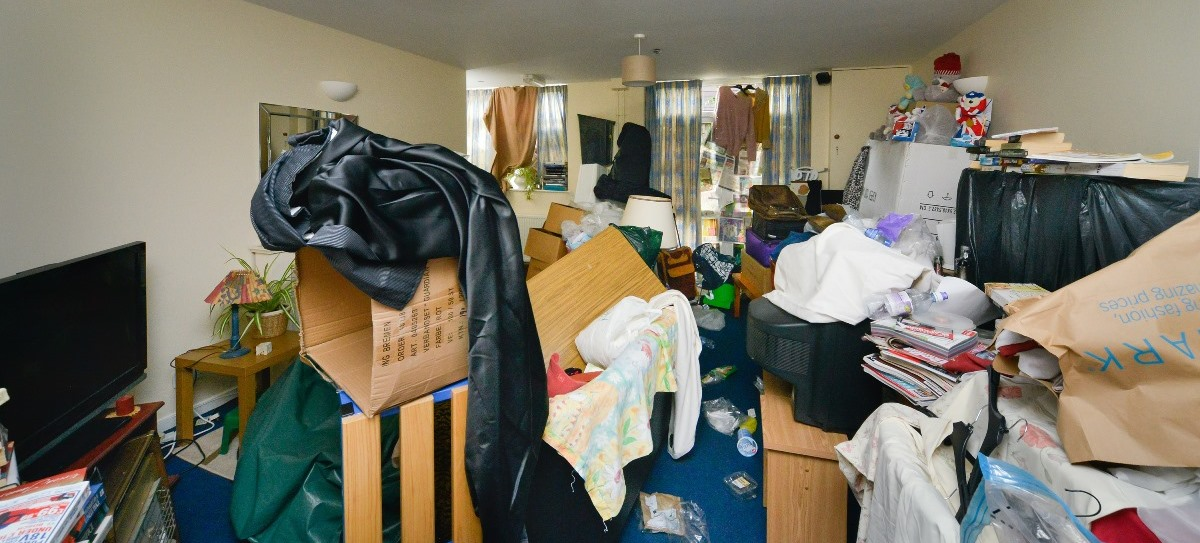 Image of a cluttered living room due to hoarding