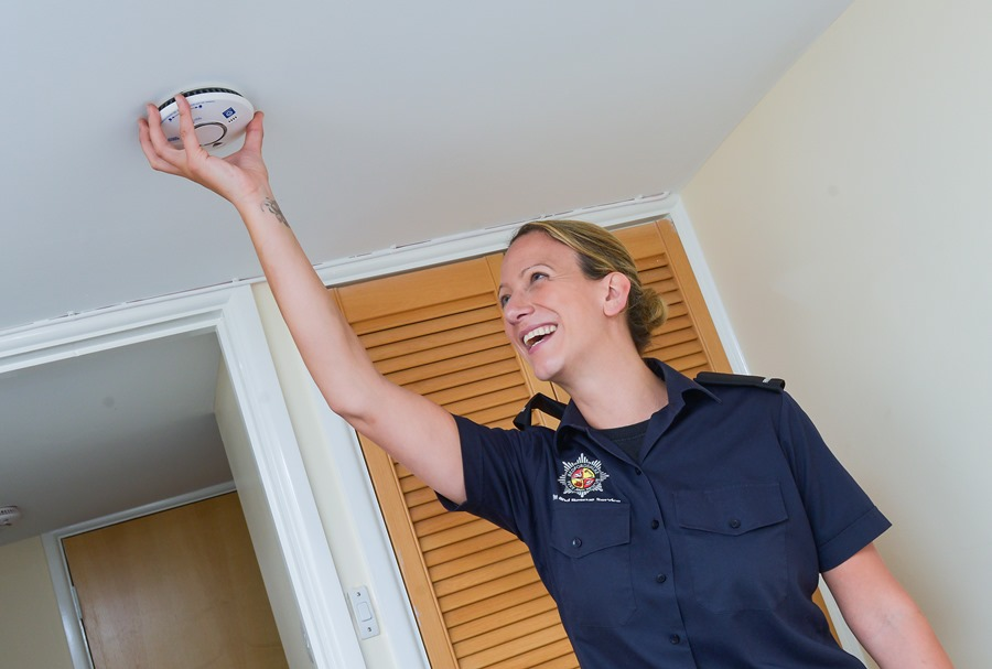Firefighter fitting smoke alarm